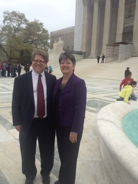 """Mary Steele Williams, Executive Director of Association for Molecular Pathology (AMP), and Dr. Roger Klein, MD, JD, AMP leader, outside the Supreme Court Building, Washington, D.C., during AMP v. Myriad in 2013."""" (Provided by AMP)"""